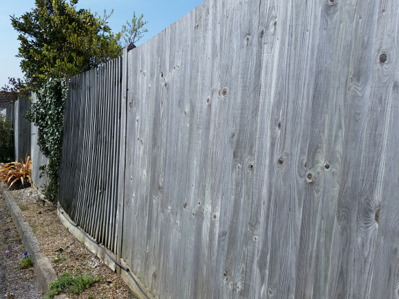 Wind Damaged Wooden Fencing