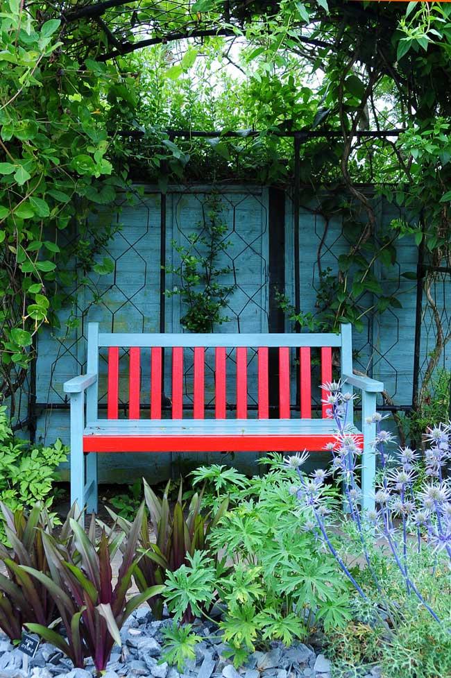 Painted bench in pretty garden