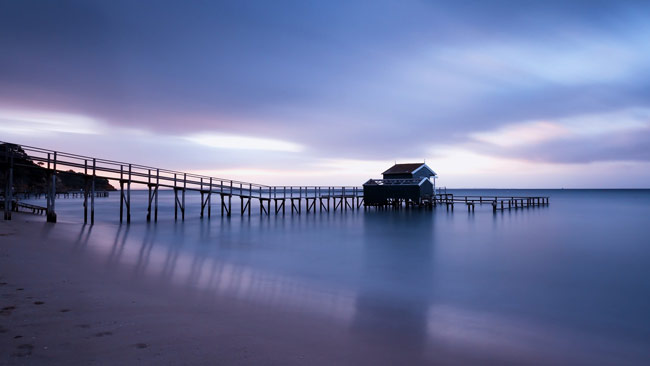 Seaside Jetty at Dawn with Blue Sea and Sky